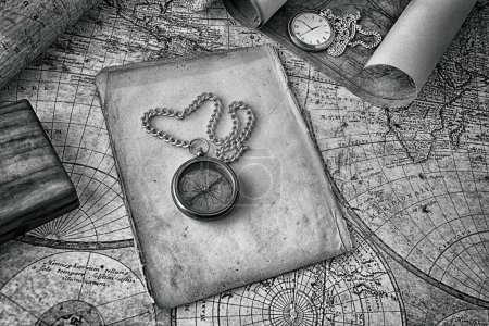 Photo for Vintage compass and a pocket watch lying on  old map - Royalty Free Image