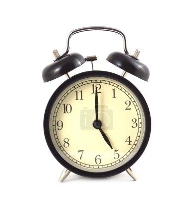 Black alarm clock shows 5 isolated