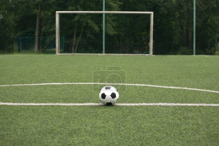 Classic black and white ball for playing soccer on sports ground
