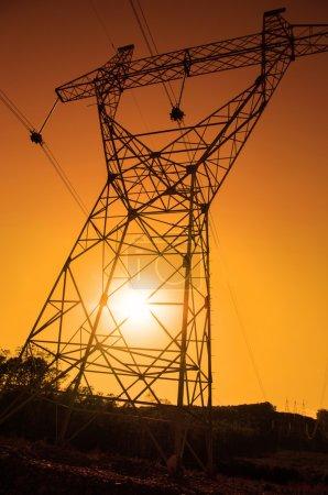 Foto de Torre eléctrica, potencia energética, puesta de sol - Imagen libre de derechos