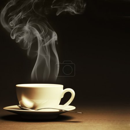 Photo for Cup of hot coffee with steam on dark background. Toned image. - Royalty Free Image