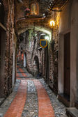 Narrow street in Dolceacqua, Liguria, Italy
