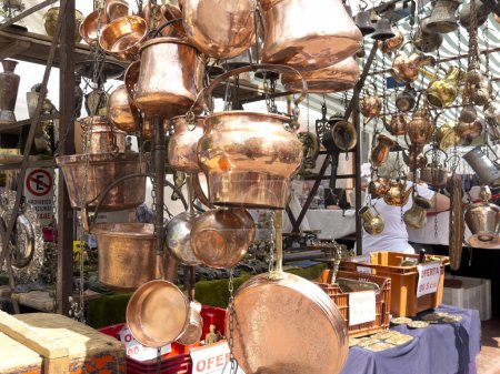 Selling old copper cookware. San Telmo market in B...