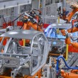 Robots welding in an automobile factory...