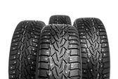 Zimní pneumatiky sada izolovaných na bílém
