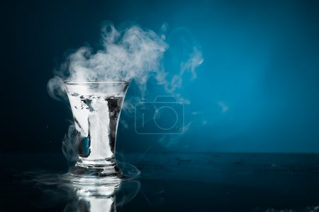 Photo for Shot glass of vodka with ice vapor - Royalty Free Image