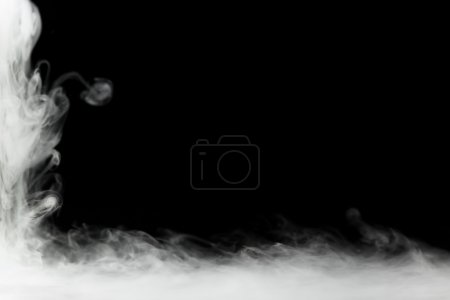 Dense smoke frame isolated on black
