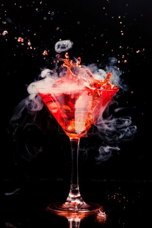 Photo for Red cocktail with splash and ice vapor - Royalty Free Image