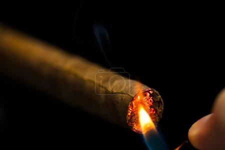 lighting up a cigar