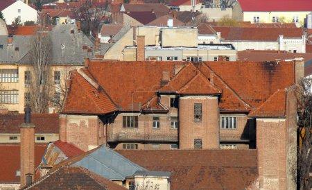 Urban scene across built up area showing roof tops
