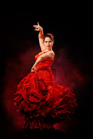 Photo for Portrait of beautiful young woman dancing flamenco in red dress - Royalty Free Image