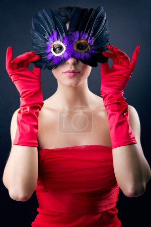 Photo for Portrait of Sophisticated woman with red dress and carnival mask - Royalty Free Image