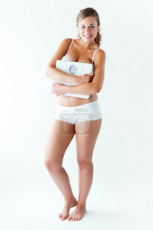 Photo pour Portrait of young girl in underwear holding scale. - image libre de droit