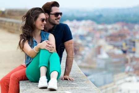 Photo for Portrait of young tourist couple looking at the views in the city. - Royalty Free Image