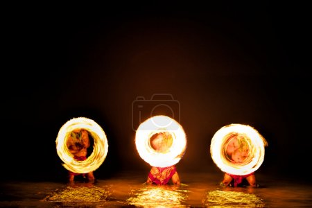 Fire Dancers Create Circles of Fire Glowing in Water