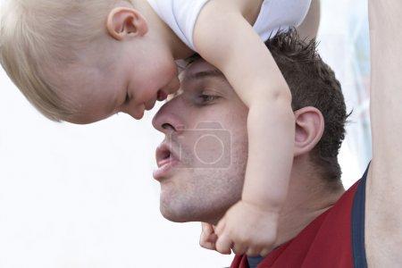 Father and sun having fun