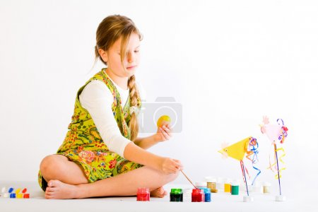 Young girl presenting her painted egg