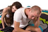 Girlfriend comforting her boyfriend who looks troubled