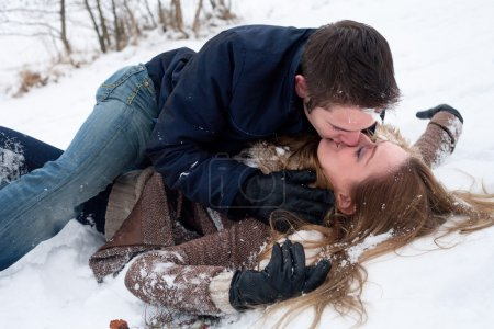 passionate snow love on the ground