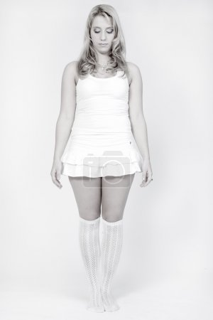 Studio portrait of a long blond girl looking very ...