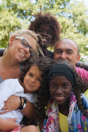 Photo for Happy multicultural family having a nice summer day - Royalty Free Image