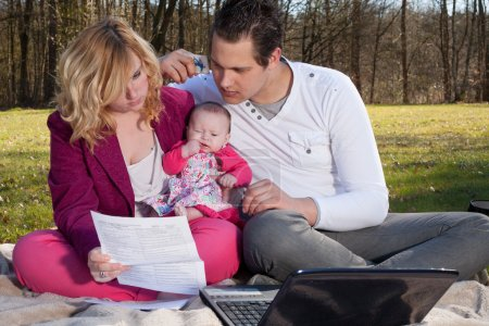 Young family busy with financials