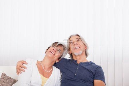Loving senior couple daydreaming