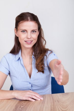 Young woman offering to shake hands