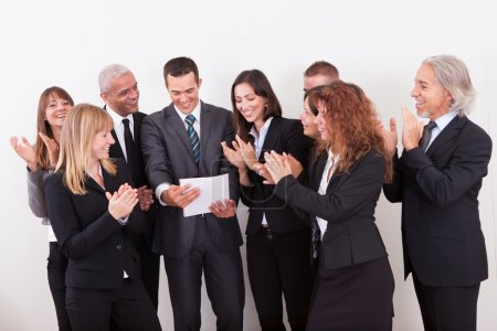 Photo for Business Team Applauding For The Success Of Colleague - Royalty Free Image