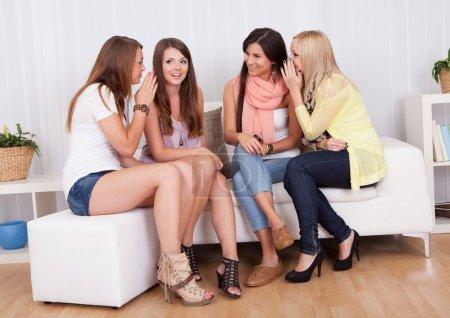 Four women gossiping