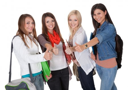 Smiling female students with a thumbs up