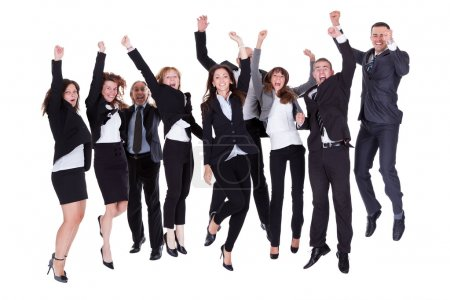 Photo for Group of jubilant business jumping for joy and shouting in their excitement at their success isolated on white - Royalty Free Image