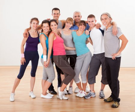 Photo for Large group of diverse male and female friends posing together at the gym in their sportswear - Royalty Free Image