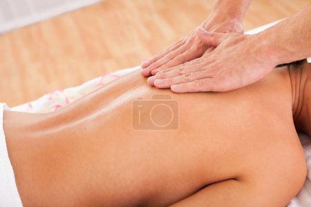 Photo for The beauty of experienced hands working through customer's back - Royalty Free Image