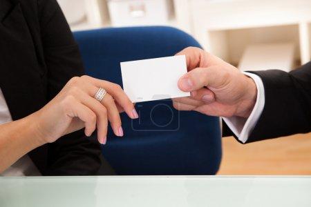 Man handing over a business card