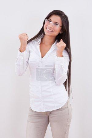 Photo pour Jubilant dame avec de nouvelles lunettes célébrant le succès - image libre de droit