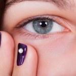 Closeup of a natural beautiful blue-grey female ey...