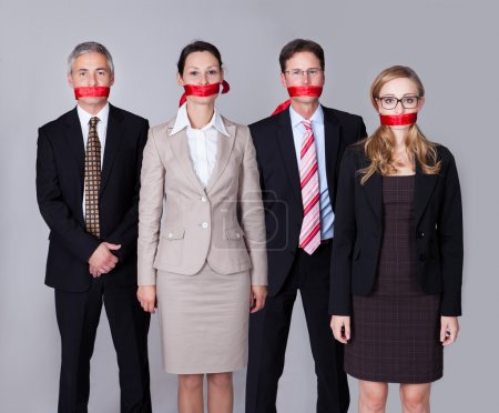 Businesspeople bound by red tape
