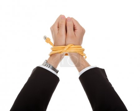 Businessman with hands tied in network cable