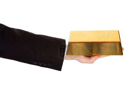 Photo for Cropped view of the arm of a businessman holding out a gold bar in a depiction of success and wealth isolated on white - Royalty Free Image