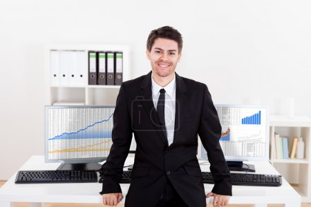 Confident smiling stock broker