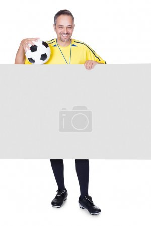 Happy Coach Holding Placard And Football