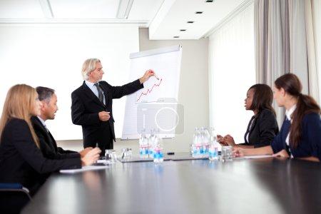 Senior male speaker giving a presentation