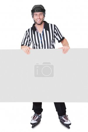Portrait of hockey judge presenting empty banner