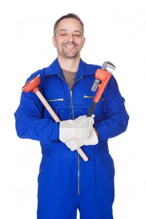 Happy Plumber Holding Plunger And Wrench