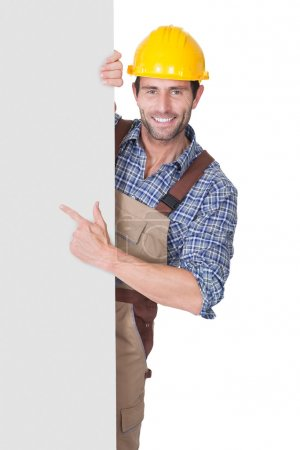 Construction worker presenting empty banner