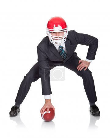 Photo for Competitive businessman playing american football. Isolated on white - Royalty Free Image