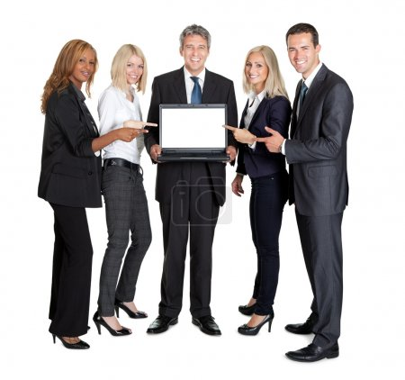 Business group pointing at the laptop