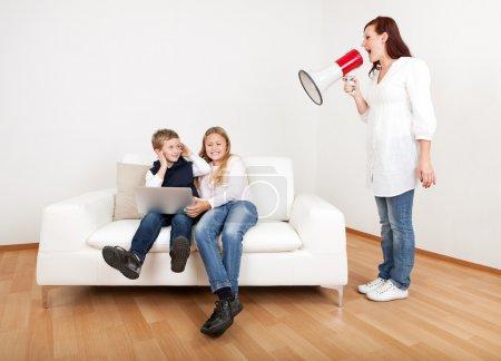 Mom screaming at kids using megaphone