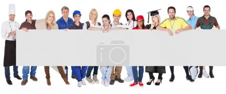 Photo for Group of diverse professionals presenting empty banner. Isolated on white - Royalty Free Image